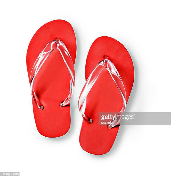 Bright red flip flops on a white background