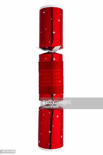 bright red foil christmas cracker - クリスマスクラッカー ストックフォトと画像