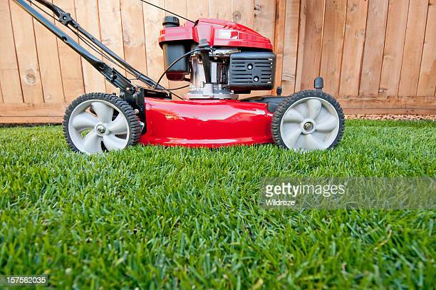 bright red lawn mower ready for business - lawn mower stock pictures, royalty-free photos & images