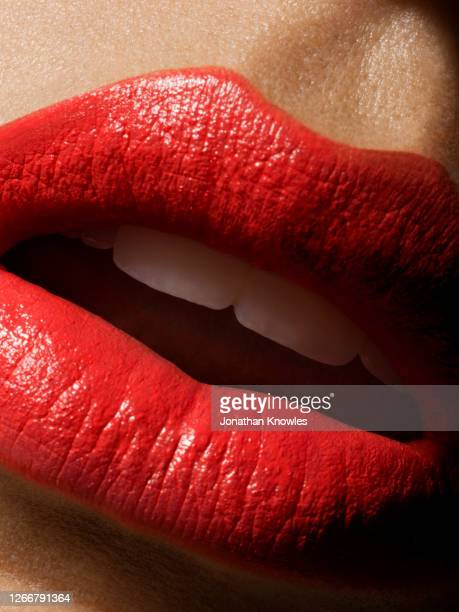 bright red lipstick - human face stock pictures, royalty-free photos & images