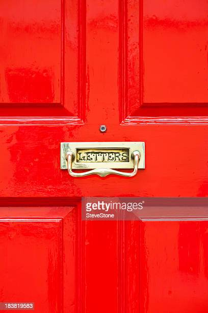 Bright red painted door with brass letterbox