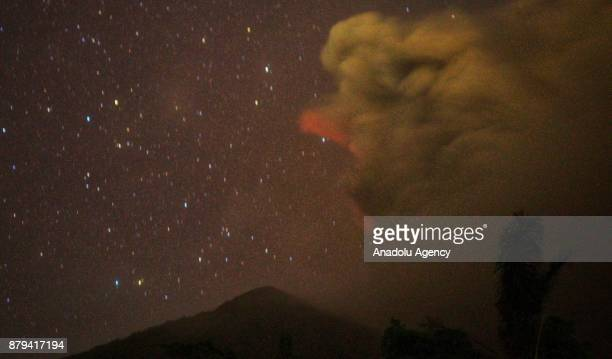 A bright red sky is seen from Besakih village of Karangasem regency 7 kilometers from the erupted Mount Agung in Bali Indonesia on November 26 2017...