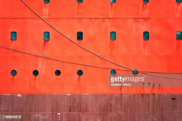 bright safety orange icebreaker ship hull - 産業用船舶 ストックフォトと画像