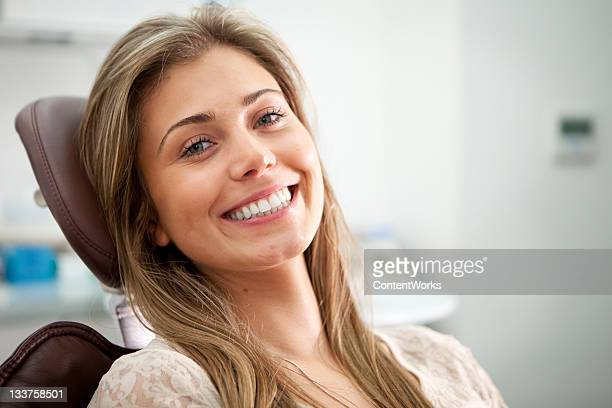 bright smile from the dentist's chair - dental equipment stock pictures, royalty-free photos & images