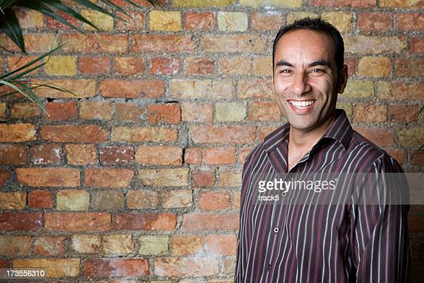 bright smiles - handsome pakistani men stock photos and pictures