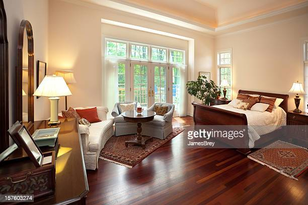 bright spacious master bedroom interior design with sitting area - feng shui stock photos and pictures