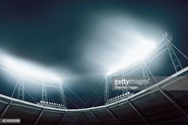 bright stadium lights against a dark blue sky - sport venue stock pictures, royalty-free photos & images