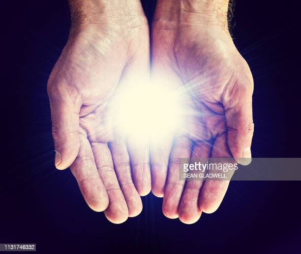 bright star in hands - hands cupped stock pictures, royalty-free photos & images