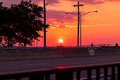 sun sets over bridge