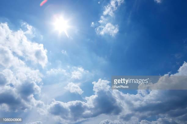 bright sunshine glare against blue sky - summer ストックフォトと画像