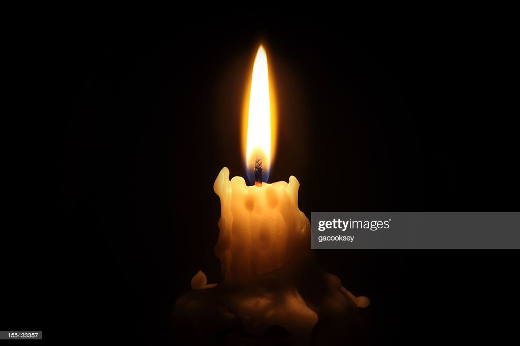 Bright waxy candle burns down : Stock Photo