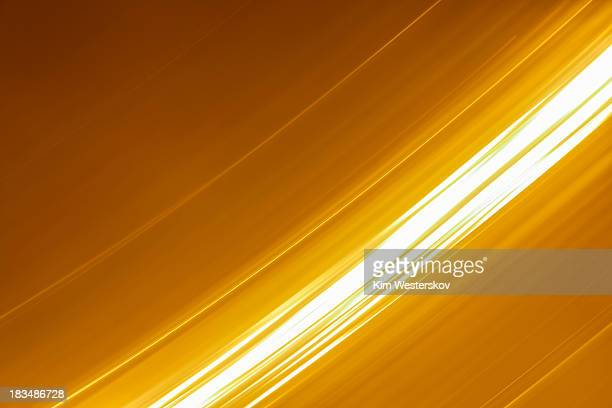 bright white lights moving on gold - white gold stock pictures, royalty-free photos & images