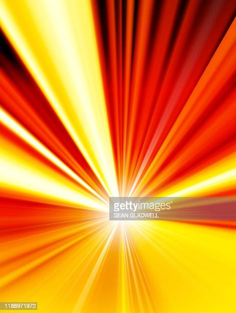 bright yellow and orange starburst - zoom background stock pictures, royalty-free photos & images