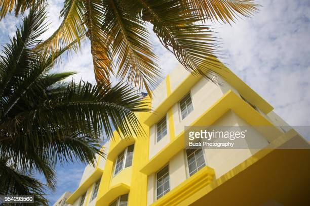 bright yellow and white facade of residential building in miami beach, miami, florida, usa - florida usa stock-fotos und bilder