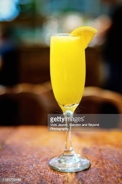 bright yellow lemon cocktail served at brunch on long island - mimosa stock pictures, royalty-free photos & images