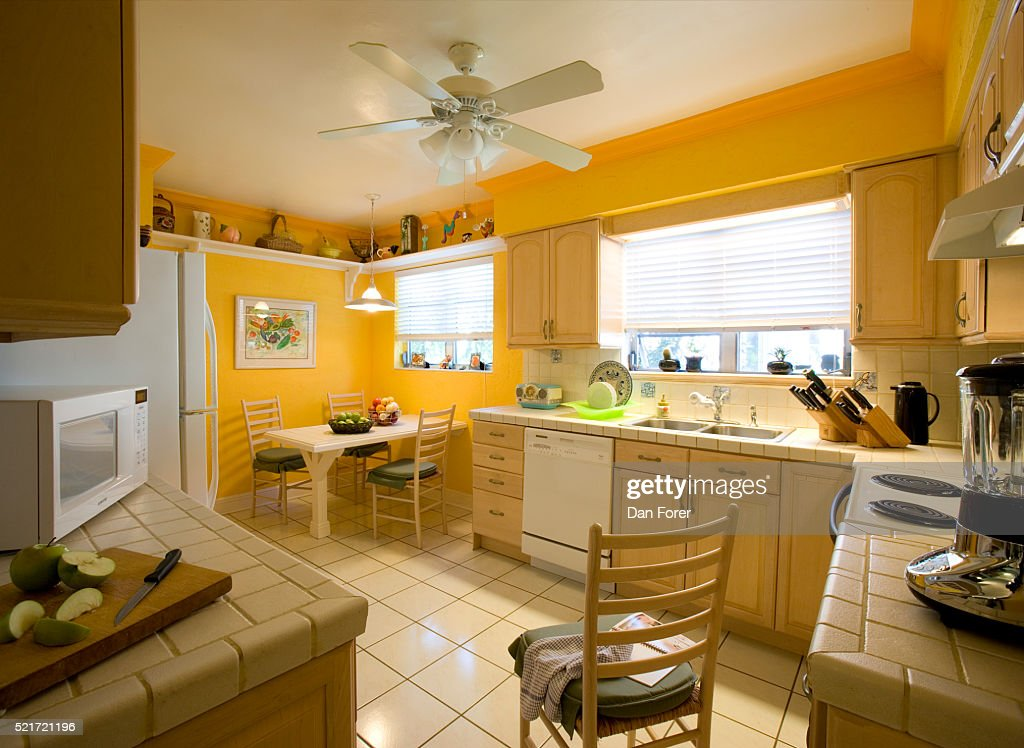 Bright Yellow Walls In Kitchen Stock Photo