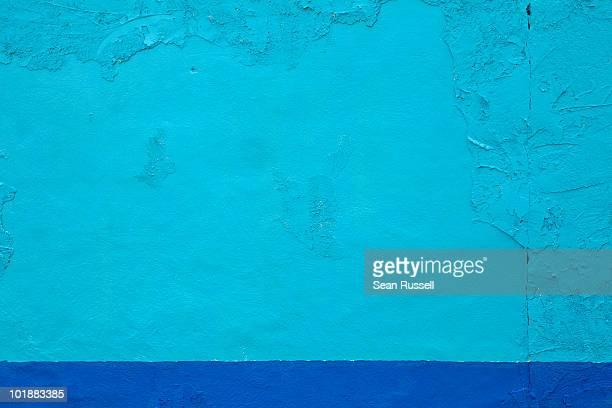 A brightly colored blue wall