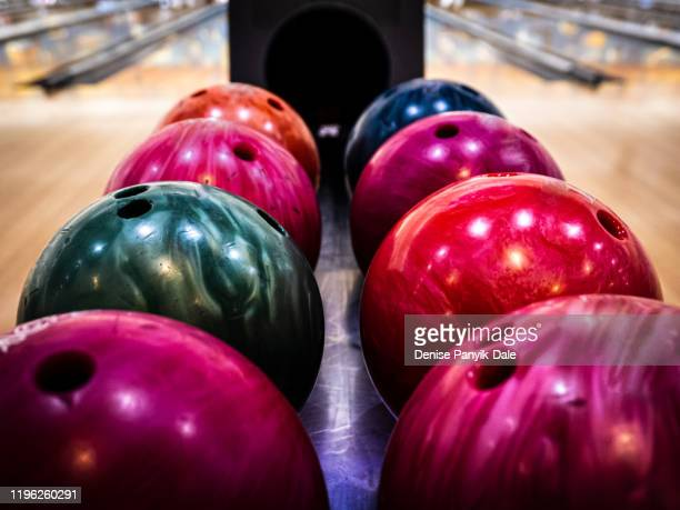 brightly colored bowling balls - ball stock pictures, royalty-free photos & images