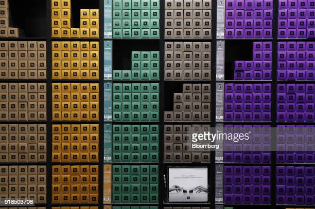 Brightly colored cartons of Nespresso coffee capsules stand on display in a shop at the Nestle SA headquarters in Vevey Switzerland on Thursday Feb...