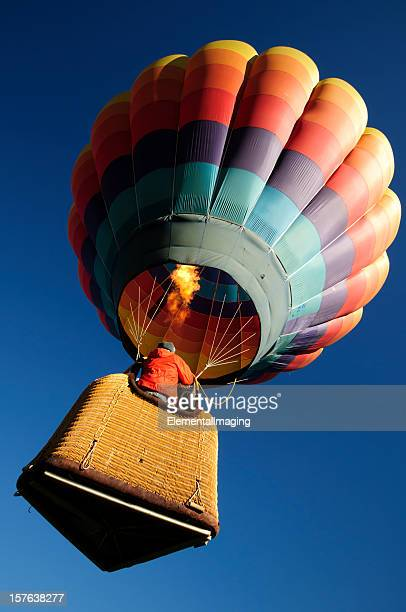 brightly colored hot air balloon launching wide  angle close-up - hot air balloon stock pictures, royalty-free photos & images