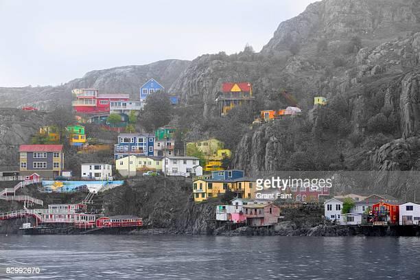 brightly colored houses near ocean - paisajes de st johns fotografías e imágenes de stock