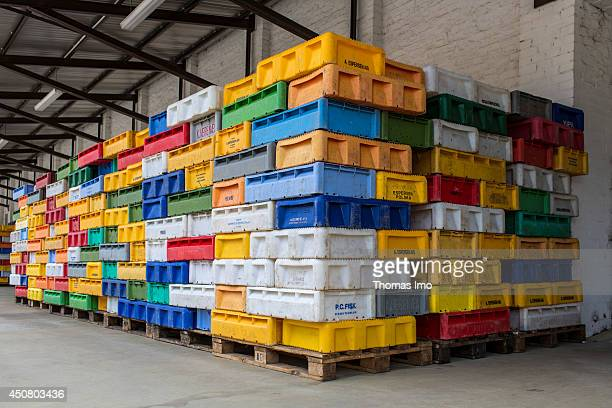 Brightly colored plastic boxes used for fish transportation piled up on pallets at Sassnitz harbour as seen on April 20 2014 in Sassnitz on the...