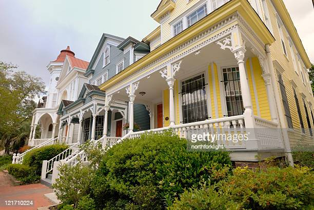 brightly colored row houses - victorian style stock pictures, royalty-free photos & images