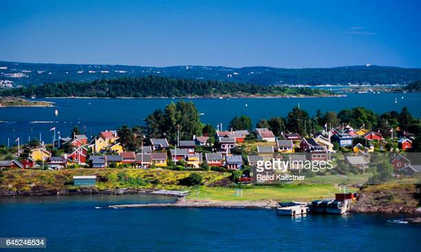 Brightly colored vacation houses on the waterway south of Oslo, Norway.