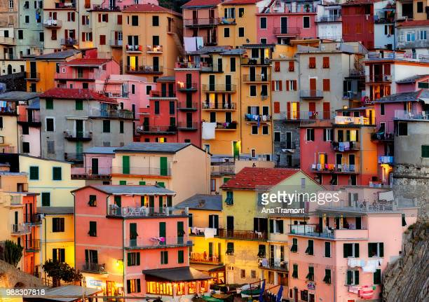 brightly coloured architecture in manarola, liguria, italy. - liguria stock photos and pictures