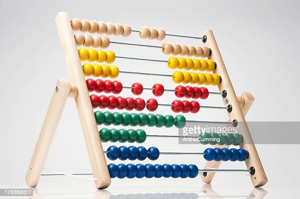 Brightly coloured child's abacus on white background