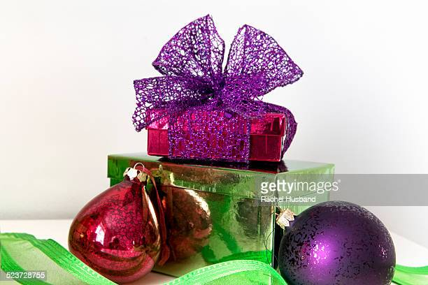 Brightly coloured Christmas presents and baubles