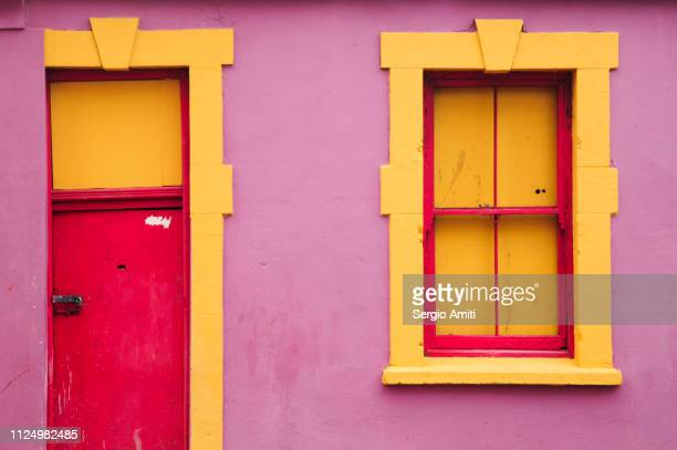 brightly coloured house in cape town - cape town stock pictures, royalty-free photos & images