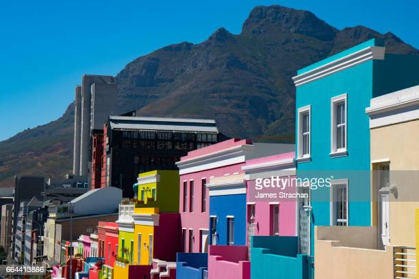 Brightly coloured houses with mountains in the background, Waal Street in Bo-Kaap area (Malaysian/Muslim), Cape Town, South Africa