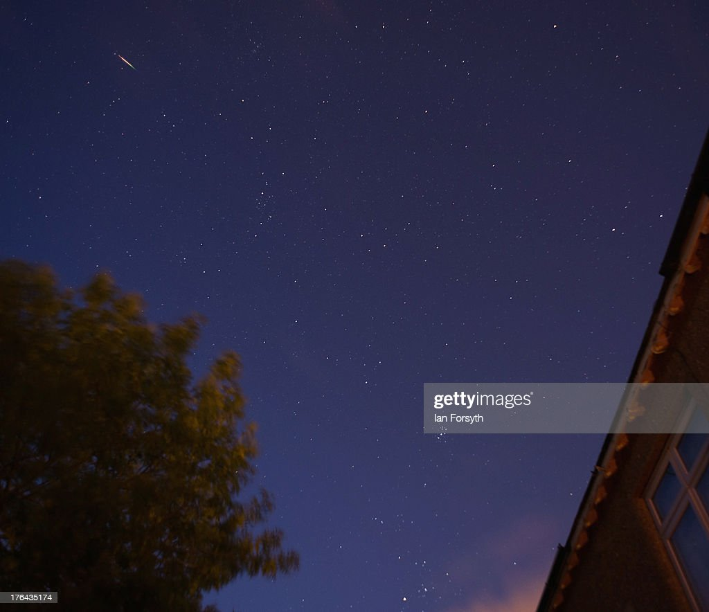 A brightly coloured meteor streaks across the early morning sky on August 13, 2013 over Saltburn, United Kingdom. The Perseid Meteor shower is visible from mid-july each year with peak activity being between the 9th and 14th of August. During the peak, the rate of meteors can reach 60 or more per hour. They can be seen all across the sky as they gradually fall away from the tail of the Swift-Tuttle comet.
