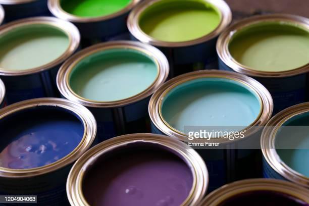 brightly coloured paint - farbeimer stock-fotos und bilder