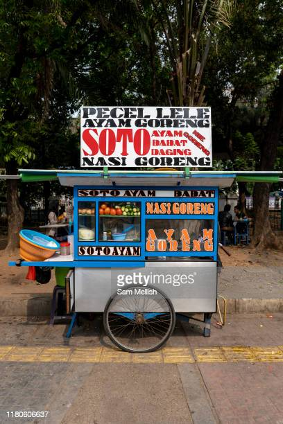 Brightly coloured street food carts in Central Jakarta near Merdeka Square on the 2nd November 2019 in Java in Indonesia