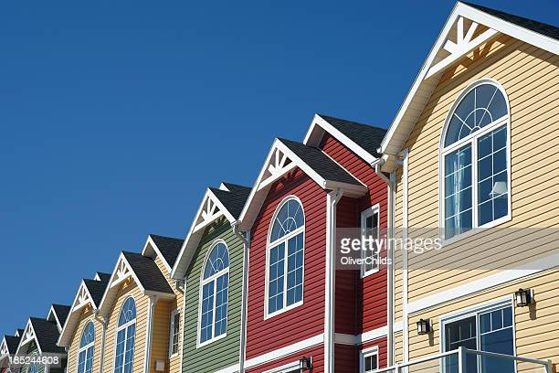 brightly coloured town houses - terraced_house stock pictures, royalty-free photos & images