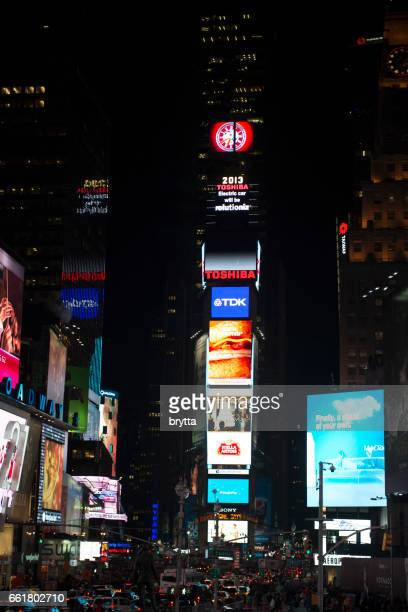 Brightly illuminated billboards at night advertising at Times Square , a very famous place in Midtown Manhattan in New York City,USA