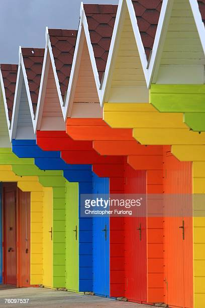 Brightly painted beach huts wait for holiday makers on 14 August Scarborough England The traditional British seaside holiday has managed to maintain...