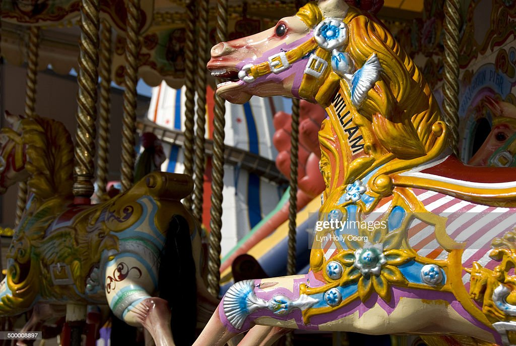 Brightly painted carousel horses : Stock Photo