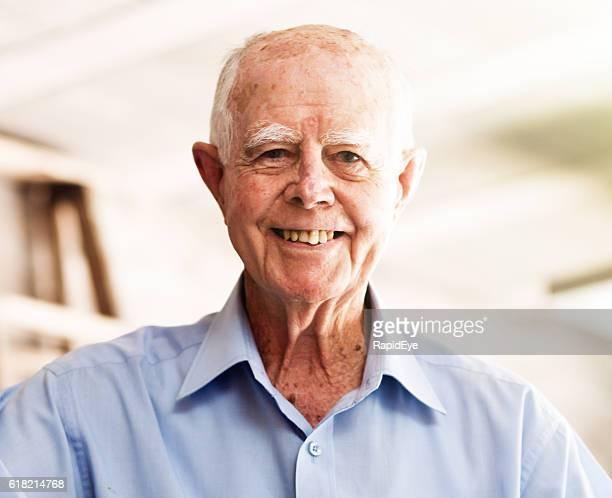 Brightly smiling 90 year old active senior man enjoying life