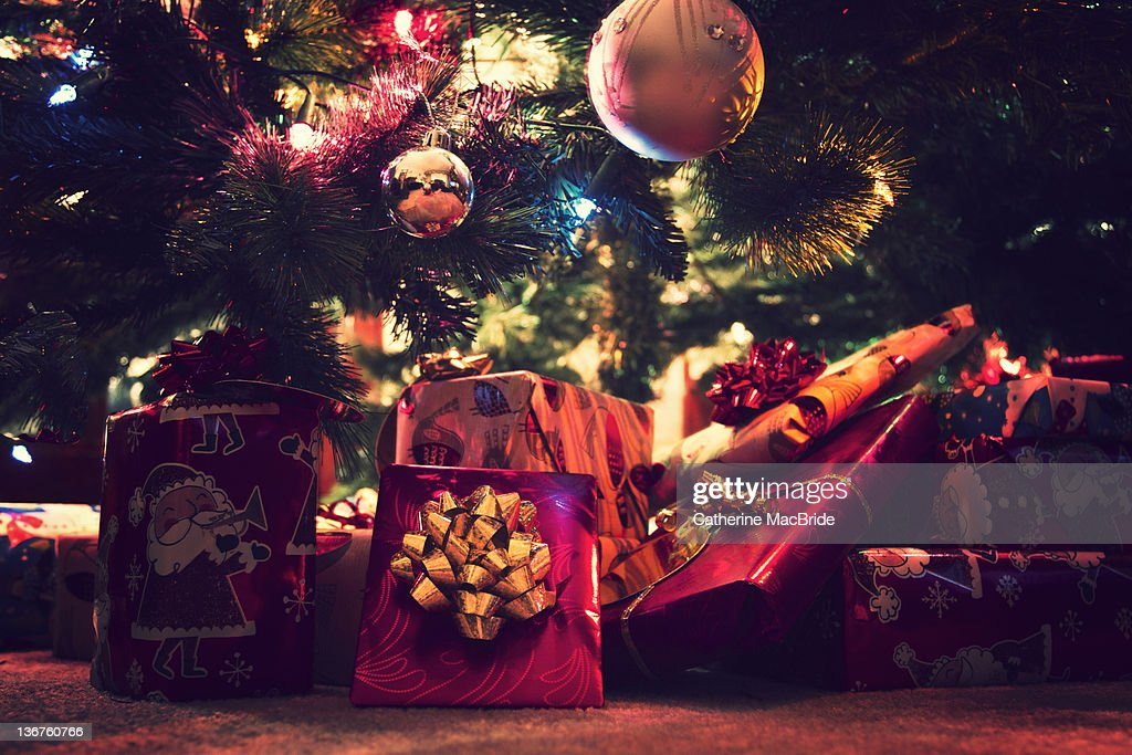 Brightly wrapped Christmas presents : Stock Photo