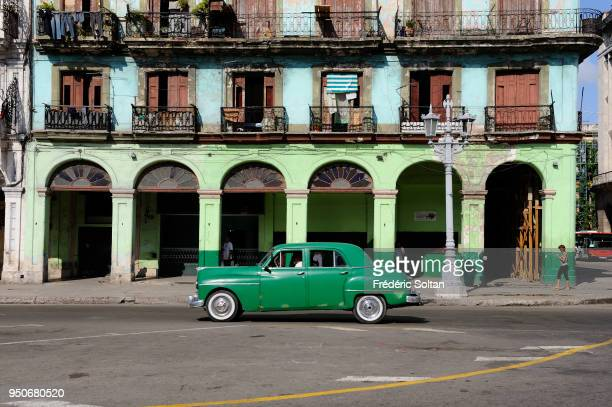 Brightlypainted buildings on Paseo de Marti opposite the National Capitol Building in Havana on August 02 2017 in Havana Cuba
