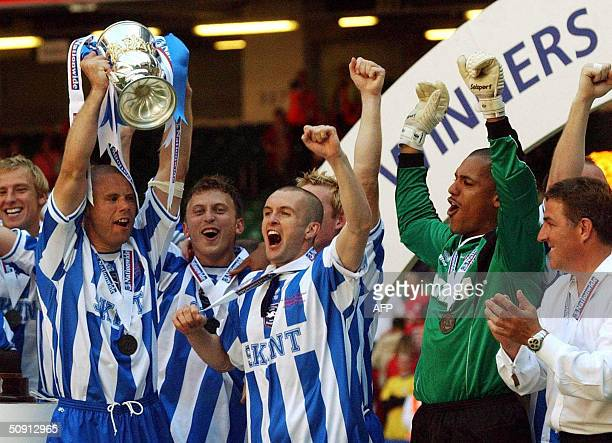 Brighton and Hove Albion captain Danny Cudlipp celebrates with his team mates after they beat Bristol City 1-0 to win the Nationwide Division Two...