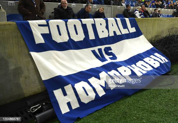 Brighton and Hove Albion fans display an anti homophobia flag during the Premier League match between Brighton Hove Albion and Watford FC at American...