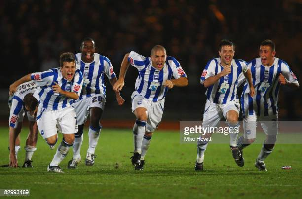 Brighton and Hove Albion players celebrate as Matt Richards scores the decisive penalty in the shoot out during the Carling Cup Second Round match...