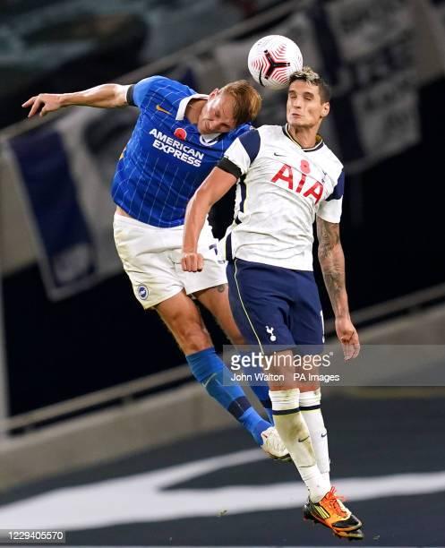 Brighton and Hove Albion's Dan Burn and Tottenham Hotspur's Erik Lamela battle for the ball during the Premier League match at The Tottenham Hotspur...