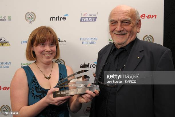 Brighton and Hove Albion's Disability Football Development Manager Teresa Sanders and Community Scheme Manager Dick Knight with their award for The...