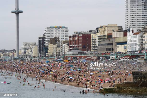 Brighton beach is packed as the South of England basks in a summer heatwave on August 08, 2020 in Brighton, United Kingdom. Parts of England are...