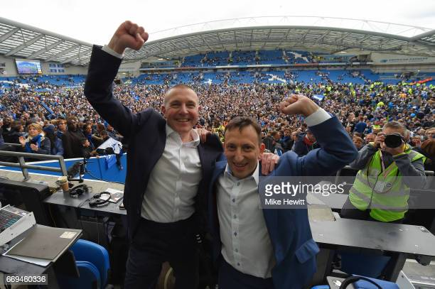 Brighton CEO Paul Barber and Chairman Tony Bloom celebrate at the end of the Sky Bet Championship match between Brighton Hove Albion and Wigan...